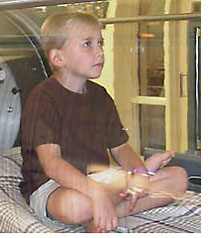 An autistic boy receiving hyperbaric oxygen therapy